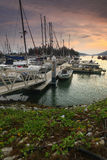 Beautiful composition view of Malaysian Harbour with a yatch during sunset Royalty Free Stock Photo