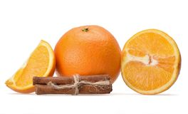 Beautiful composition of whole and sliced oranges and flavored cinnamon sticks royalty free stock images