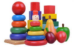Beautiful composition with woden toys, pyramids, fruits and cub Royalty Free Stock Image