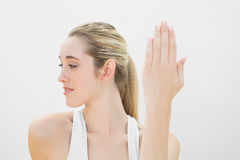 Beautiful concentrated woman stretching Royalty Free Stock Photo