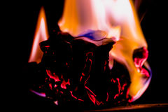 Beautiful concept flames. Fire on burns paper with black background. Soft Focus stock photos