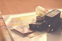 Beautiful concept for summer travel. Map with sunset and accessories for vacation planning. Stock Photos