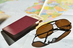 Beautiful concept for summer travel. Sunglasses with passport. Planning a summer vacation and holidays. Royalty Free Stock Image