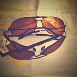 Beautiful concept for summer travel. Sunglasses with passport. Planning a summer vacation and holidays. Stock Photography