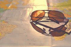 Beautiful concept for summer travel. Sunglasses with passport. Planning a summer vacation and holidays. Royalty Free Stock Photo