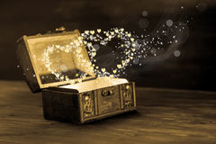Beautiful concept of vintage chest with light heart miracle on w Royalty Free Stock Photography