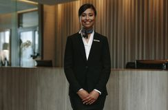 Beautiful concierge waiting for welcoming guests Stock Images