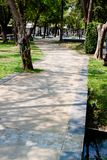 Beautiful concrete walking way inside natural garden decorate view. Freshing air time Royalty Free Stock Photos