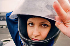 Beautiful confidence girl in racing helmet. Close up Stock Photos