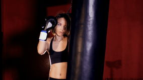 Beautiful confident athletic woman boxing. Woman strength concept.