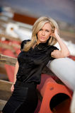 Beautiful confident blond fashion model on site Stock Images