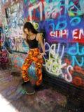 Beautiful confident brunette teenager skater girl royalty free stock photo