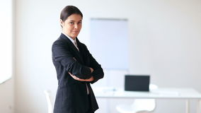 Beautiful confident business woman in the office stock footage