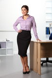 Beautiful confident business woman standing smilin Royalty Free Stock Photo