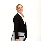 Beautiful confident businesswoman. In a stylish black jacket carrying a folio file smiling happily at the camera Stock Image