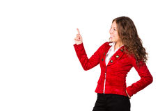 Beautiful confident businesswoman pointing her finger at copyspace Stock Images