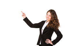 Beautiful confident businesswoman pointing her finger at copyspace Royalty Free Stock Photo