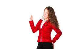 Beautiful confident businesswoman pointing her finger at copyspace Royalty Free Stock Image