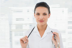 Beautiful confident female doctor with stethoscope Royalty Free Stock Images