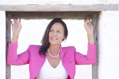 Beautiful confident lady in pink portrait Royalty Free Stock Photos