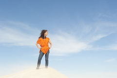 Beautiful and confident woman on top of hill Stock Images