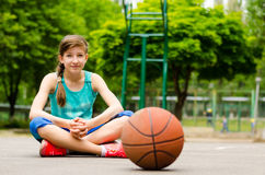 Beautiful confident young female basketball player Stock Photos