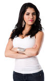 Beautiful confident young woman. Beautiful confident self-secure attractive young woman standing with arms crosses wearing white shirt, isolated Stock Photos