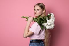 Beautiful confused unhappy girl with long blonde hair royalty free stock photos