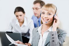 Beautiful consultant. Portrait of beautiful consultant with headset in the office Stock Photo