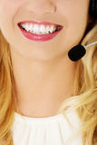 Beautiful consultant of call center in headphones.  Royalty Free Stock Images