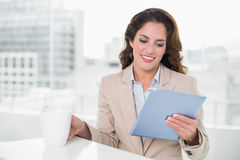 Beautiful content businesswoman using tablet Stock Photo