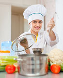 Beautiful cook  in toque prepares veggie lunch Stock Photo