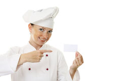 Beautiful cook woman holding blank card Stock Photo