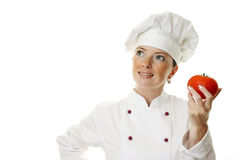 Beautiful cook woman holding tomatoes Stock Photos