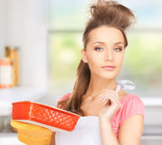 Beautiful cooking housewife Stock Photo