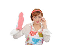 Beautiful cooking woman in apron and kitchen glove Stock Photos