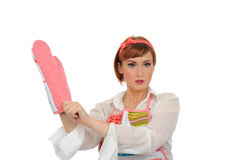 Beautiful cooking woman in apron and kitchen glove Stock Image