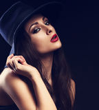 Beautiful cool female model with long hair posing in blue fashio Stock Image