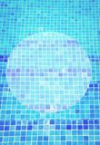 Beautiful cool water in swimming pool. Mosaic bottom abstract summer background Stock Photos