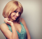 Beautiful coquette young woman with blonde short hair style. Vin Royalty Free Stock Image