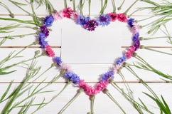 Beautiful cornflowers in shape of heart Royalty Free Stock Photos