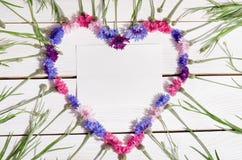 Beautiful cornflowers in shape of heart Stock Photography