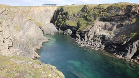 Beautiful Cornish cove with clear blue sea in summer stock footage