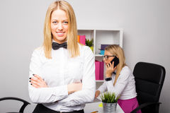 Beautiful corporate business woman standing with her hands crossed Royalty Free Stock Images