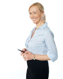 Beautiful corporate female using cellphone Stock Images