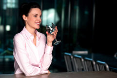 Beautiful corporate lady drinking water Stock Photo