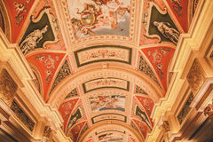 Beautiful corridor with golden decoration and painting on ceiling Royalty Free Stock Photos