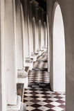 Beautiful corridor with old chequered floor tiles Stock Image