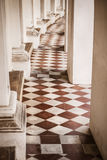 Beautiful corridor with old chequered floor tiles Stock Images