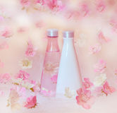 Beautiful cosmetic background. With white and pink flowers royalty free stock images
